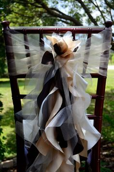 Set of 10 Custom Chair Sash Curly Willow by elegantsashesandmore on Etsy Great for wedding, or reception. These are similar to Wildflower Linens & Less and I could resell them after the wedding!