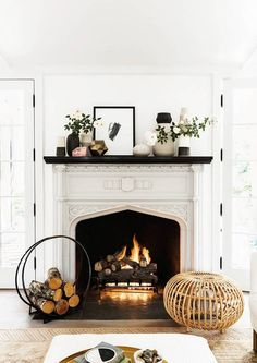 A cozy fireplace wit