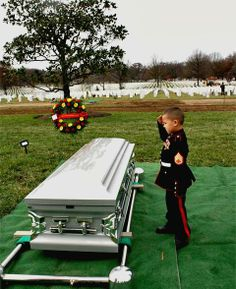 Rochester, N.Y.- Staff Sergeant Javier Ortiz-Rivera called his boys his little Marines. He loved playing with them and teaching them how to salute and stand tall. The youngsters used those lessons to bid their father farewell. Wearing tiny Marine uniforms made especially for them, they saluted their father as he was laid to rest at Arlington National Cemetery.