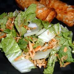 """Asian Salad Recipe - Delicious!  Modifications: 1/4 cup oil, 3 Tbsp vinegar, 3 Tbsp sugar, 2 Tbsp soy sauce for dressing; only need 2 Tbsp butter to toast almonds/seeds; used """"Fresh Gourmet"""" Garlic Ginger wonton strips in place of ramen noodles (in produce section; added last to salad; gave great flavor)"""