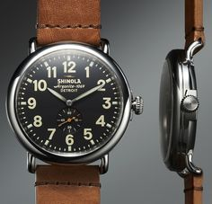 THE RUNWELL BY SHINOLA with a SwissArgonite 1069 Movement, a stainless steel case and it's all handmade in Detroit. From a design perspective, the watch has a classic pre-WWII design with a minimalist dial and a water-resistance rating of 5ATM