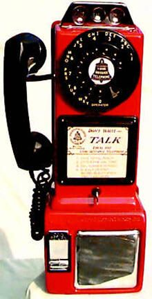 antique red and black payphone