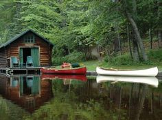 canoes and a cabin on a lake. yes please.