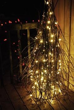DIY Stick Tree ~ using a tomato cage, sticks and lights. I'm making this soon. Would be more rustic looking and blend better outdoors.