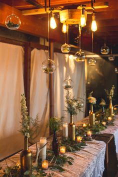 hanging wedding decor, photo by Continuum Photography http://ruffledblog.com/boho-san-diego-wedding #weddingideas #terrariums #receptions