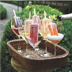 For summer BBQ with girlfriends, fruit Popsicles with champagne!