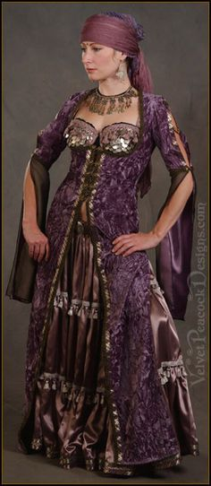 A ghawazee coat can be worn over pants or a skirt and can show off a cabaret style bra. good for costume changes as it acts as a cover up for another costume.