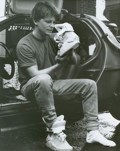 Back to the future II. Marty Mcfly putting on a pair of NIKE Mag 2015
