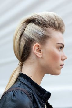 refinery29–Clover Canyon's take on the ponytail gave the impression of a faux-hawk, but one that was still feminine and pretty, thanks to a soft fullness through the top.
