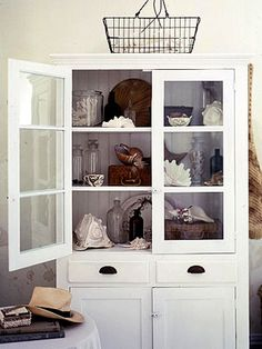 Vintage White Hutch with Shells by Carol Faust via Country Living 2003 & Country Home 2010