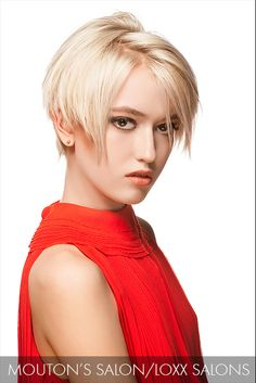 Precision-cut bangs fall across the brow and graze this model's cheekbones, emphasizing the jagged part and platinum hue.