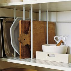 Tension Rods are Great	 Utilize tension curtain rods in your cupboard to create mini cubbies for pans, baking sheets and serving trays upright!     #kitchen, #organization, #storage, #cutting-board, #kitchen-cabinets, #kitchen-tools    View entire slideshow: 17 Kitchen Organization Tips & Tricks on http://www.stylemepretty.com/collection/240/