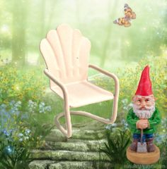 A tiny metal chair and little gnome in the fairy garden.