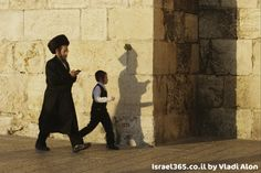 Father and son walking through the streets of Jerusalem's Old City. .  Train up a child in the way that he should go,