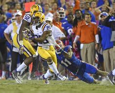 Advocate staff photo by TRAVIS SPRADLING -- LSU safety Rickey Jefferson is dragged down by Florida receiver Demarcus Robinson after his interception in the final seconds of the fourth quarter Saturday, Oct. 11, 2014