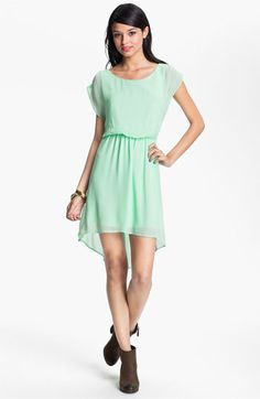 love this mint green high low dress with a white belt