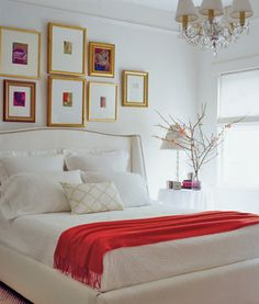 white linens with a pop of color. and gold frames!
