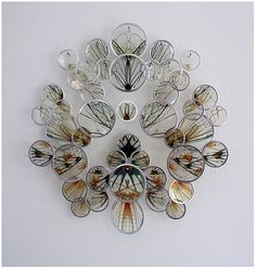 Alan Bur Johnson makes delicate clustered sculptures that consist of transparencies in silver frames mounted on dissection pins