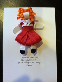 Annie- Sweet little orphan Annie in her white collared dress complete with curly red hair.