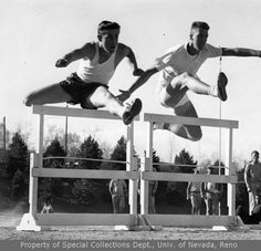 Track team: two unidentified hurdlers  (ca. 1958)
