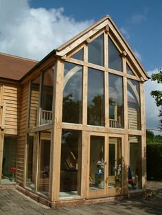 Mainly timberframes and post and beam interiors on for Timber frame sunroom addition