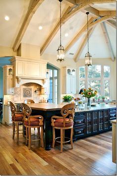 French Country Kitchen with Rustic Ceiling Beams  Love the cream cabinets around  and the dark in the center island, can use different kind/color stone for island.