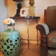 Decorating Decision making on a budget. This classic ceramic stool and lovely flowers both from HomeGoods