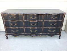 """French Provincial Dresser in distressed Kettle Black with high gloss polyurethane,  repurposed for media center. The sky is the limit with how re-purposed pieces can be transformed into coat racks, magnetic chalk boards, key chain holders and accent pieces. ~ Create this look on your re-purposed piece!  Our DIY ebook """"Facelift Your Furniture"""" can show you how.  Purchase and download for only $10 at www.faceliftyourfurniture.com."""