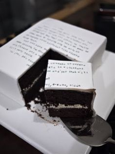 Eat Your Words Cake - Chocolate mud cake with cookies n' cream buttercream and Dark chocolate ganache and white fondant.