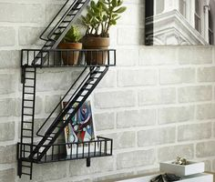 Made of sturdy epoxy-coated steel, the wall-mounted shelf is designed to look like three levels of a fire escape. The Urban Shelf can be used to store pens and pencils, magazines, mail, chachkis, plants or anything else that will fit on one of the three landings.