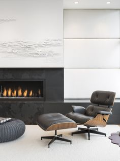 interesting wall treatment over a linear fireplace lounges, fireplaces, interiors, eames, walnut, lounge chairs, silver blond, reading chairs, interior design chairs