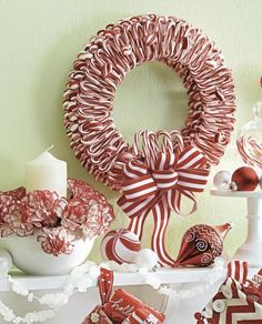 How to make this festive candy cane wreath, as pictured on our Nov/Dec 2013 cover: http://www.midwestliving.com/homes/seasonal-decorating/beautiful-holiday-wreaths/?page=8