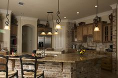 Remodel idea - cover side panels with fake brick? Refinish cabinets - add windowed doors for variety.  Like the lights.......black accents