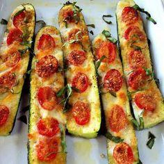 Zucchini halves -tomatoes. I made this tonight. Yum!