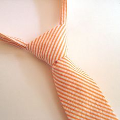 Orange and white seersucker tie.