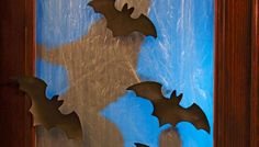 Give your home's exterior a creepy makeover just in time for Halloween with spooky bats and frosted glass windows.