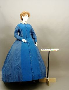 Blue gaberdine maternity dress with a ribbed front panel, circa 1860. Via Kentucky Historical Society.
