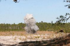 An explosive charge detonates during a training event aboard Camp Lejeune, N.C., Feb. 15, 2012. Marines with 2nd Explosive Ordnance Disposal Company, 8th Engineer Support Battalion, 2nd Marine Logistics Group headed to the field to refine their skills in combating explosive devices.