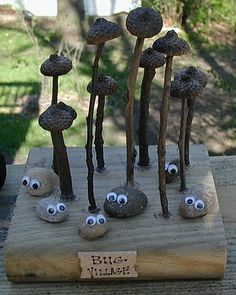 Bug Village - nature craft for children using googly eyes on rocks