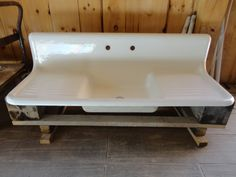 """This is a great double drainboard sink with high sides and high integral backsplash. It also does not have an apron front which allows it to sit on a set of drawers and cabinets. Available on ebay. This is a 1930 double drain board """"Standard"""" sink. The sink is approx 60"""" wide at widest by 22"""" front to back by 13 1/2"""" high. The backsplash is 12"""" and the lip is 1 1/2"""".  The sink is 80+ years old"""