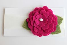 I have made these flowers for The Girl, but this one has more layers than I usually make.  I like it!  (This one is on Etsy)