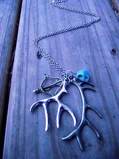 deer antler necklace + bow/arrow + turquoise skull // Etsy // If I wore jewelry...