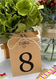 Kraft paper table number labels for your centerpiece. #wchappyhour Stationery: Printed Love Co. ---> http://www.weddingchicks.com/2014/05/17/printed-love-co/
