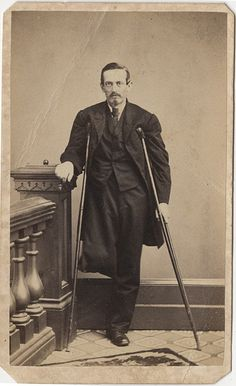 Man with One Leg on Crutches - Carte de Visite: by Chas. E. Wallin  Co. of York, Pennsylvania has a green 3 cent revenue stamp on the back. This means that it was taken during the American Civil War. The man with one empty pants leg pinned up might be a veteran returned from the war.