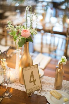 Gold bottle centerpieces tabl number, table numbers