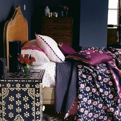 Deep purple/gray with Magenta...awesome colors together. Layers of prints/fabrics for bedding is a Y E S.  I fall over for dark walls...