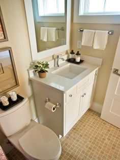 17 Clever Ideas for Small Baths: Basin and pedestal sinks are great options for visually expanding your space, but a traditional sink with included storage is often essential. Keep a light-colored counter clutter free in order to keep a larger cabinet from overwhelming the small space.  From DIYnetwork.com