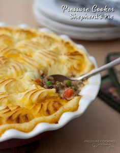Shepherd's Pie Recipe from Pressure Cooking Today - Creamy, cheesy mashed potatoes swirled on top of a rich, flavorful ground lamb and vegetables. Yum