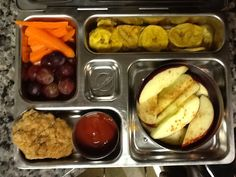 Grapes and carrots, plantain chips, apples w/cinnemon, and a homemade (grain free) chicken nugget