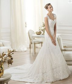 I LOVE the lace on this Pronovias wedding dress. The way it falls is so romantic and elegant.